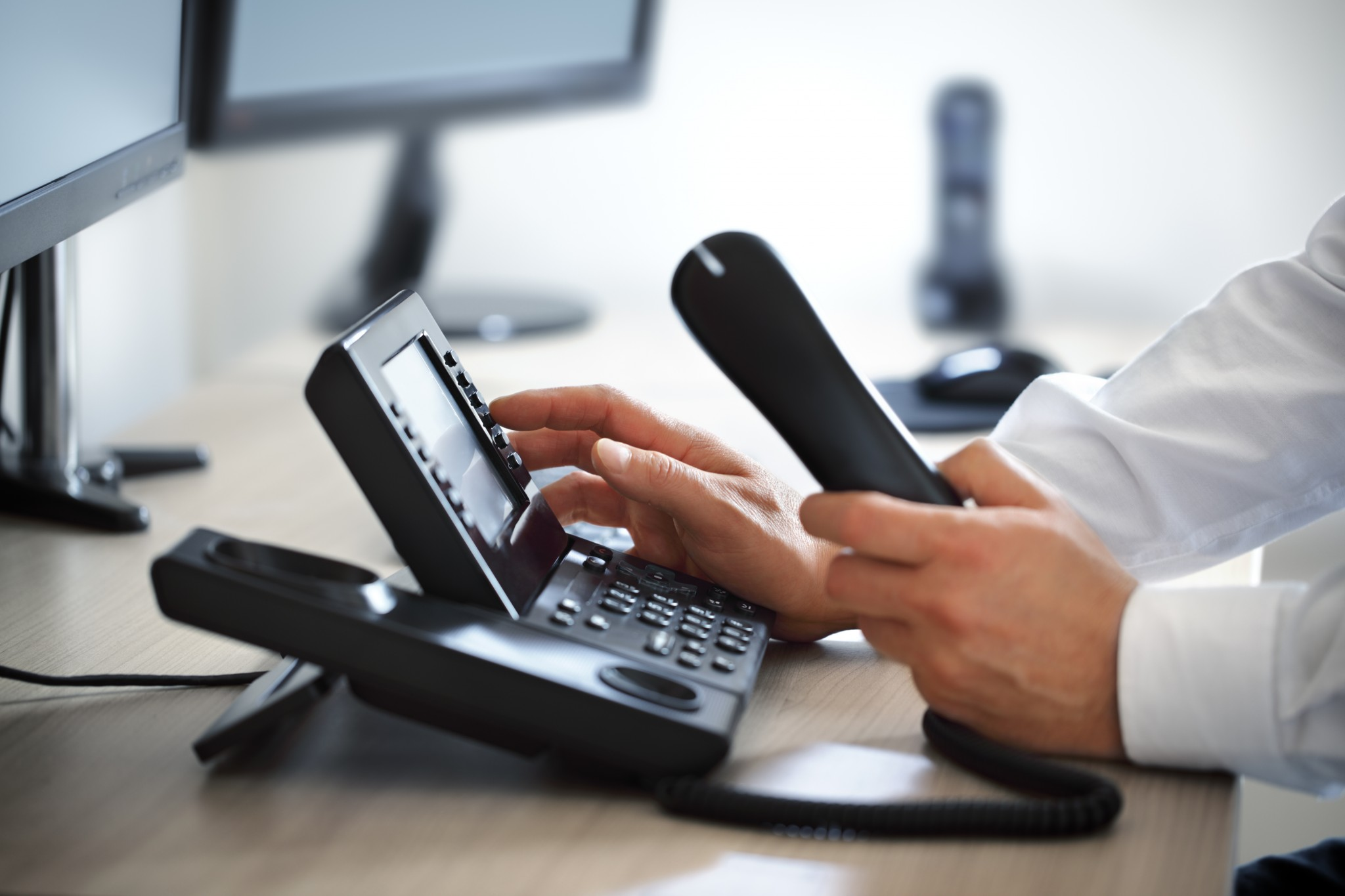 bigstock-Dialing-telephone-keypad-conce-86579804